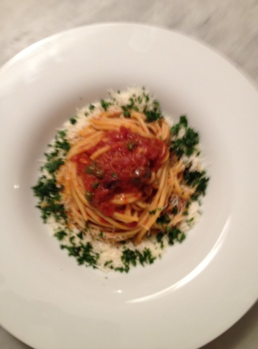 spaghetti alla puttanesca, anchovies olives caper and tomatoes, the best dress up
